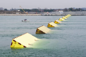 Blocks of the mobile gates of the Experimental Electromechanical Module (Mose), a project intended to protect Venice from floods, emerge during technical tests at the 'Bocca di Porto' at Venice's Lido (Photo by LUCA_ZANON/Corbis via Getty Images)