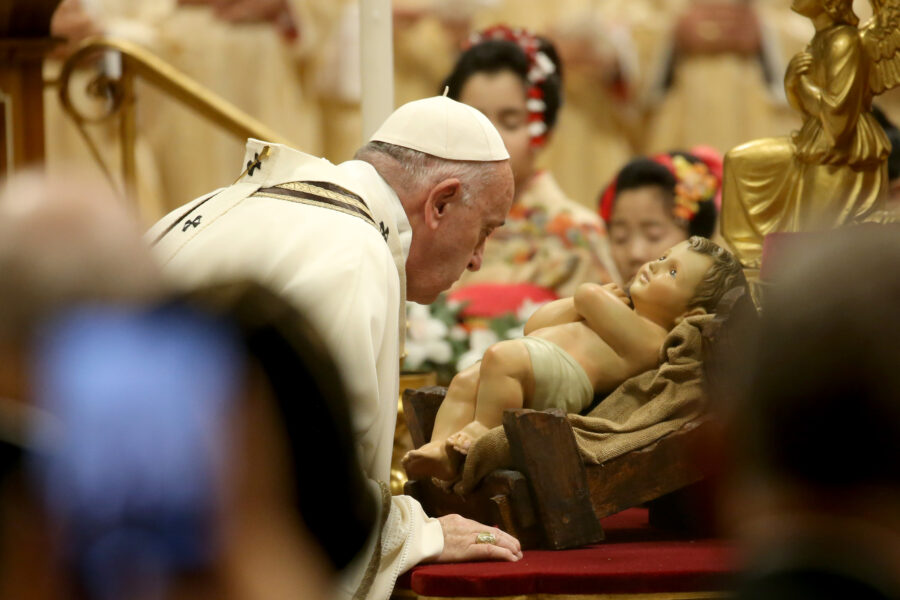 VATICAN CITY, VATICAN – DECEMBER 24: Pope Francis  kisses a figurine of Baby Jesus  as he celebrates the Christmas Eve Mass in St. Peter's Basilica on December 24, 2019 in Vatican City, Vatican. (Photo by Franco Origlia/Getty Images)