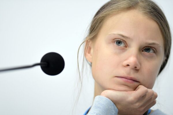 """Swedish climate activist Greta Thunberg holds a press conference with other young activists to discuss the ongoing UN Climate Change Conference COP25 at the 'IFEMA – Feria de Madrid' exhibition centre, in Madrid, on December 9, 2019. – The COP25 summit opened on December 2 with a stark warning from the UN about the """"utterly inadequate"""" efforts of the world's major economies to curb carbon pollution, in Madrid, after the event's original host Chile withdrew last month due to deadly riots over economic inequality. (Photo by CRISTINA QUICLER / AFP)"""