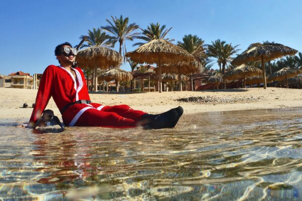 A Lebanese freediver wearing a Father Christmas (Saint Nicholas or Santa Claus) poses along the water off the coast of the northern city of Batroun on December 19, 2019. (Photo by Ibrahim CHALHOUB / AFP)