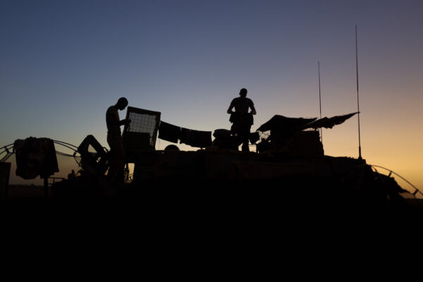 Soldiers of the French Army hang their laundry out to dry in at a Temporary Operative Advanced Base (BOAT) during the Bourgou IV operation in northern Burkina Faso on November 10, 2019. – For two weeks in early November, soldiers of the French Army set up a Temporary Operative Advanced Base (BOAT) every evening during the Bourgou IV operation, in the area of the three borders between Mali, Burkina Faso and Niger. There, with their Malian, Burkinabe and Nigerian partners, they combed forests and swamps in search of weapons caches and other jihadist equipment in an area known to harbour them. (Photo by MICHELE CATTANI / AFP)