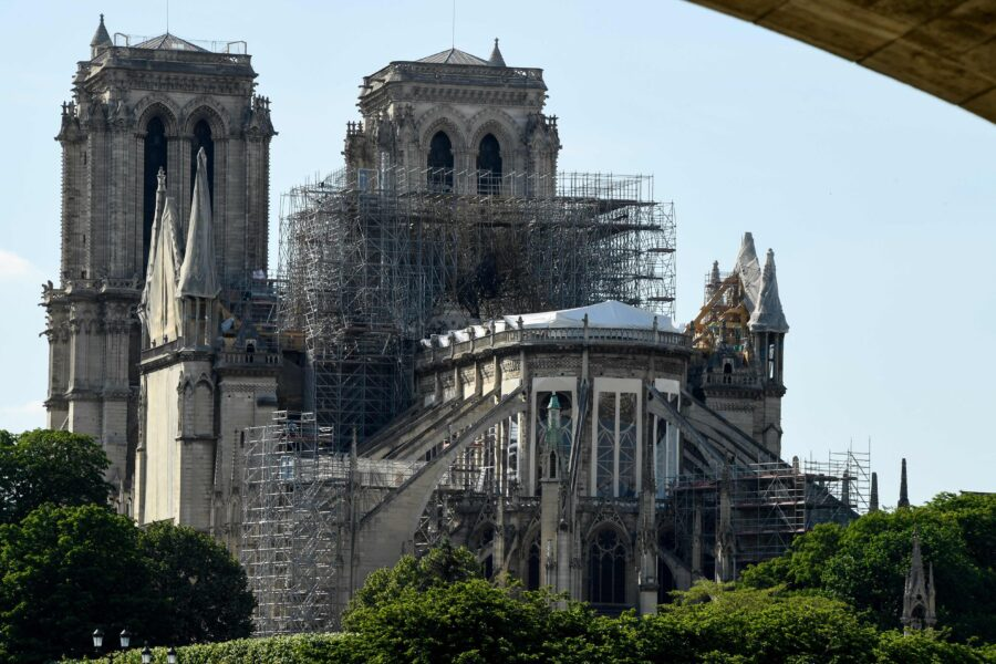 (FILES) This file photo taken on May 31, 2019 shows scaffoldings set up on Notre-Dame de Paris cathedral, under repair after it was badly damaged by a huge fire on April 15, in the French capital Paris. – At the end of 2019, the Notre-Dame consolidation project is focused on the preparations for the dismantling of the huge scaffolding installed before the fire, which poses a potential danger for the cathedral. A 94-meter high crane, will be installed in December on the south side along the Seine, to take down to the ground one by one the pieces of this scaffolding. (Photo by Bertrand GUAY / AFP)