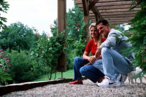 Corinna and Michael Schumacher are sitting in their gazebo on the premises of their villa in Vufflens le Chateau, Switzerland, on August 13th 1996. (Attention: minimum ree 200 Euro) Photo: Wolfgang Groth