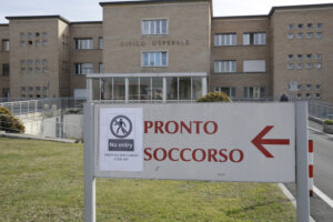 A sign attached on the indication for Emergency of the hospital of Codogno, near Lodi in Northern Italy, advises that access is not allowed Friday, Feb. 21,2020. Health officials reported the country's first cases of contagion of COVID-19 in people who had not been in China. The hospital in Codogno is one of the hospitals – along with specialized Sacco Hospital in Milan – which is hosting the infected persons and the people that were in contact with them and are being isolated. (AP Photo/Luca Bruno)