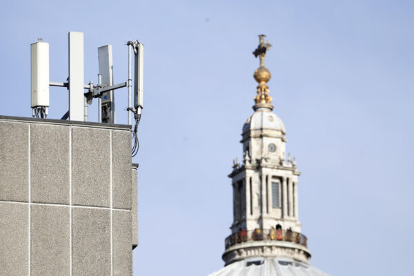 "Mobile network phone masts are visible in front of St Paul's Cathedral in the City of London, Tuesday, Jan. 28, 2020. The Chinese tech firm Huawei has been designated a ""high-risk vendor"" but will be given the opportunity to build non-core elements of Britain's 5G network, the government has announced. The company will be banned from the ""core"", of the 5G network, and from operating at sensitive sites such as nuclear and military facilities, and its share of the market will be capped at 35%. (AP Photo/Alastair Grant)"