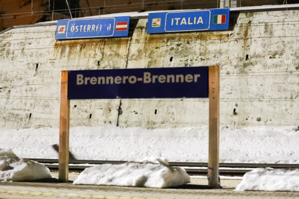 The name plaque of the Brenner train station stand at the border between Austrian and Italy at the Brenner Pass, Italy, Sunday, Feb. 23, 2020. Austria halted all train traffic to and from Italy following fears that a train on Sunday night had two people on board who may have been infected with the COVID-19 virus. (AP Photo/Matthias Schrader)