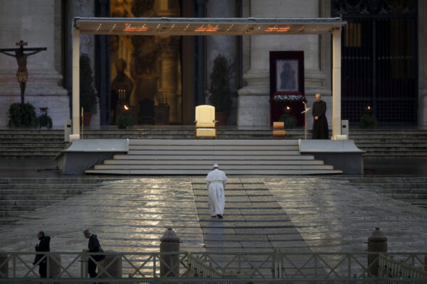"Pope Francis arrives to deliver an Urbi et orbi prayer from the empty St. Peter's Square, at the Vatican, Friday, March 27, 2020. Praying in a desolately empty St. Peter's Square, Pope Francis on Friday likened the coronavirus pandemic to a storm laying bare illusions that people can be self-sufficient and instead finds ""all of us fragile and disoriented"" and needing each other's help and comfort. The new coronavirus causes mild or moderate symptoms for most people, but for some, especially older adults and people with existing health problems, it can cause more severe illness or death. (AP Photo/Alessandra Tarantino)"