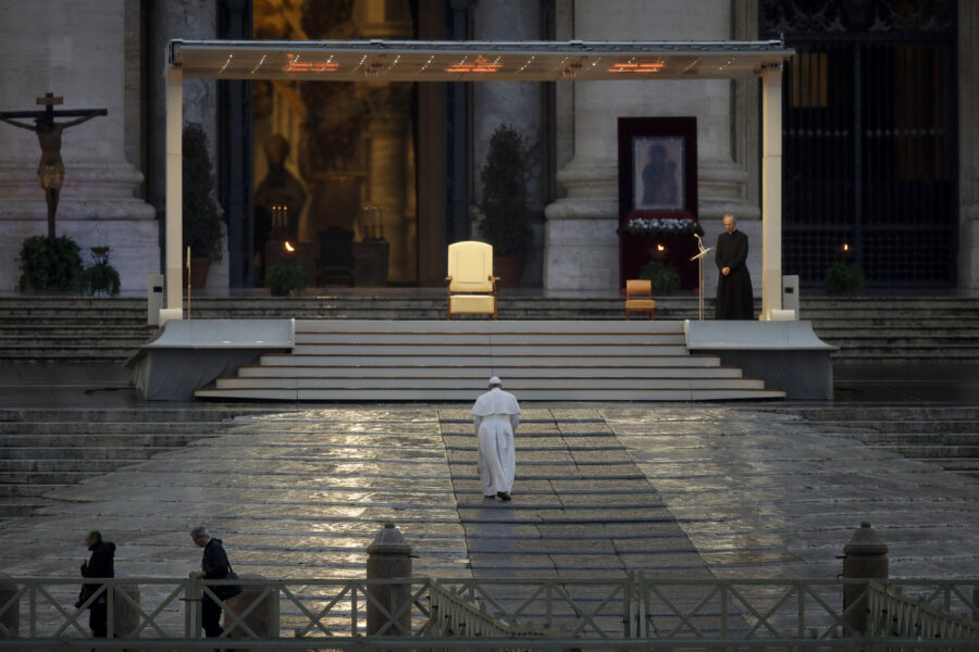 """Pope Francis arrives to deliver an Urbi et orbi prayer from the empty St. Peter's Square, at the Vatican, Friday, March 27, 2020. Praying in a desolately empty St. Peter's Square, Pope Francis on Friday likened the coronavirus pandemic to a storm laying bare illusions that people can be self-sufficient and instead finds """"all of us fragile and disoriented"""" and needing each other's help and comfort. The new coronavirus causes mild or moderate symptoms for most people, but for some, especially older adults and people with existing health problems, it can cause more severe illness or death. (AP Photo/Alessandra Tarantino)"""