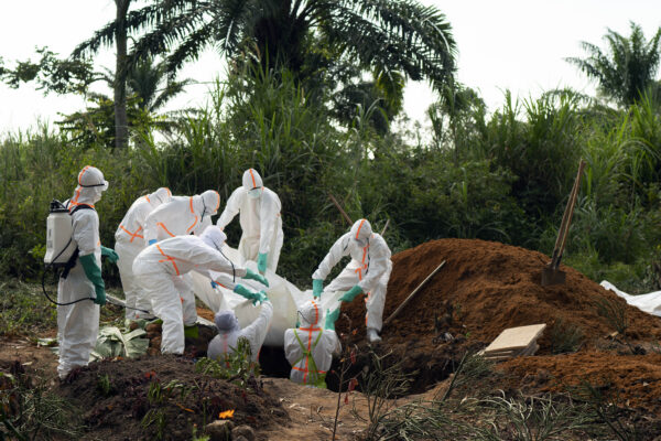 FILE – In this Sunday, July 14, 2019 file photo, an Ebola victim is put to rest at the Muslim cemetery in Beni, Congo. These African stories captured the world's attention in 2019 – and look to influence events on the continent in 2020. (AP Photo/Jerome Delay, File)