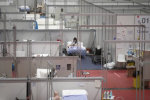 A view of a temporary field hospital set at Ifema convention and exhibition of in Madrid, Spain, Spain, Thursday, April 23, 2020, constructed to treat patients with coronavirus. (AP Photo/Manu Fernandez)