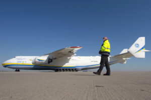 The Antonov An-225, the world's largest operational cargo plane, arrives and bringing more than eight million protective face masks from Chinese town Tianjin as a Bundeswehr transport to the Leipzig/Halle airport in Leipzig, Germany, Monday, April 27, 2020. The transport is part of the German armed forces Bundeswehr's administrative assistance in the Corona crisis. Three cargo planes carrying a total of 25 million protective face masks as Bundeswehr transports from China. (AP Photo/Jens Meyer)
