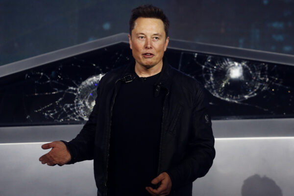 FILE – In this Nov. 21, 2019, file photo, Tesla CEO Elon Musk introduces the Cybertruck at Tesla's design studio in Hawthorne, Calif. Tesla CEO Elon Musk appears to have hit all the milestones necessary to receive a stock award currently worth about $730 million to pad the eccentric billionaire's already vast fortune. The electric car maker ended Wednesday, May 6, 2020, with an average market value of $100.4 billion for the past six months, according to data drawn from FactSet Research. (AP Photo/Ringo H.W. Chiu, File)