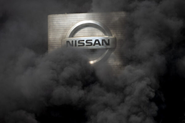 BARCELONA, SPAIN – MAY 28: The logo of Nissan is covered by smoke columns as employees burn tyres to protest against the closure of the Japanese cars manufacturer's plant, where about 3,000 people are employed,  in Barcelona, Spain on May 28, 2020. (Photo by ADRIA PUIG/Anadolu Agency via Getty Images)