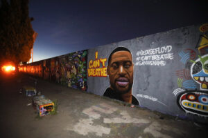 A graffiti by artist 'EME Freethinker' that depicts George Floyd is painted on a wall in the public park Mauerpark in Berlin, Germany, Friday, May 29, 2020. Floyd died after being restrained by Minneapolis police officers on Memorial Day, May 25, in the United States. (AP Photo/Markus Schreiber)