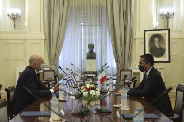 Greek Foreign Minister Nikos Dendias, left, meets with his Italian counterpart Luigi Di Maio at the Foreign Ministry in Athens, on Tuesday, June 9, 2020. (Costas Baltas /Pool via AP)