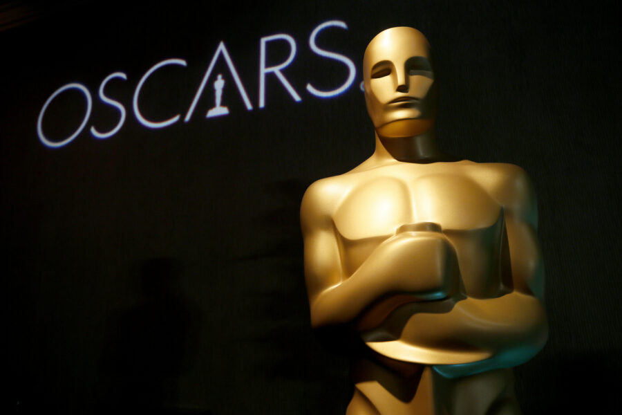 FILE – In this Feb. 4, 2019 file photo, an Oscar statue appears at the 91st Academy Awards Nominees Luncheon in Beverly Hills, Calif. The Academy of Motion Picture Arts and Sciences said Monday that the 93rd Academy Awards will now be held on April 25, 2021, eight weeks later than originally planned due to the pandemic's effects on the movie industry. (Photo by Danny Moloshok/Invision/AP, File)