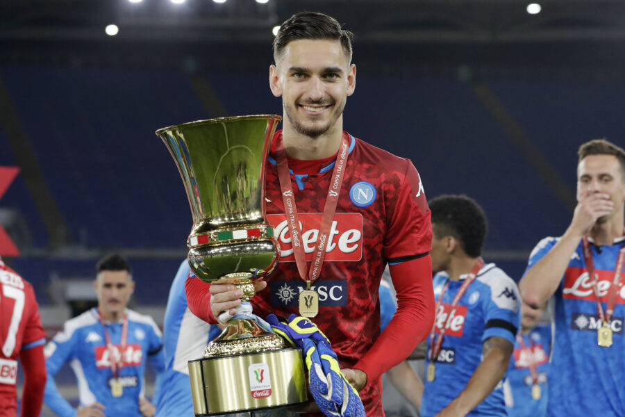 Napoli's goalkeeper Alex Meret holds the Italian Cup trophy at the end of the final match between Napoli and Juventus, at Rome's Olympic Stadium, Wednesday, June 17, 2020. (AP Photo/Andrew Medichini7