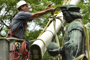 The statue of Christopher Columbus is removed from Wooster Square Park, in New Haven, Conn. Wednesday, June 24, 2020. (Peter Hvizdak/Hearst Connecticut Media via AP)