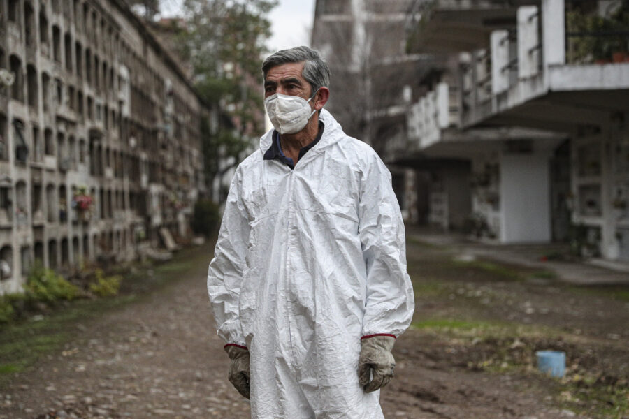 """Cemetery worker Mauricio Pardo finishes a day of work at the """"Cementerio Catolico"""" in Santiago, Chile, Saturday, June 27, 2020. The Ministry of Health reported on Saturday the highest number of deaths in Chile since the start of the new coronavirus pandemic. (AP Photo/Esteban Felix)"""