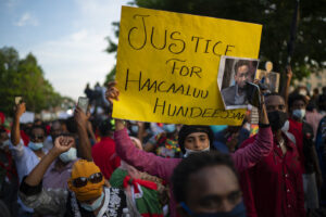 People walk along Lexington Avenue after exiting off westbound Interstate 94 on Wednesday, July 1, 2020, in St. Paul, Minn. Protesters apparently outraged by the killing of Hachalu Hundessa, a popular singer in Ethiopia, stopped traffic on the interstate during the evening rush hour. Police blocked the entrance ramps to the freeway shortly before 6:30 p.m. Traffic was stopped as the group moved down the interstate. State Patrol spokesman Lt. Gordon Shank said after 8 p.m. the protesters had left the freeway, and no arrests have been made. (Jeff Wheeler/Star Tribune via AP)