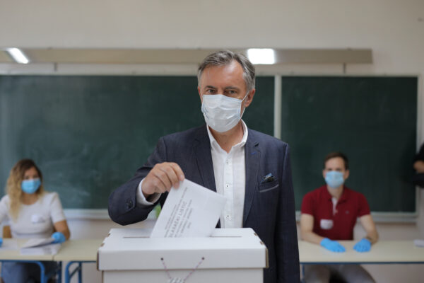 Miroslav Skoro's, leader of the Homeland Movement casts his ballot at a polling station in Zagreb, Croatia, Sunday, July 5, 2020. Amid a spike of new coronavirus cases, voters in Croatia cast ballots on Sunday in what is expected be a close parliamentary race that could push the latest European Union member state further to the right. (Antonio Bronic/Pool Photo via AP)