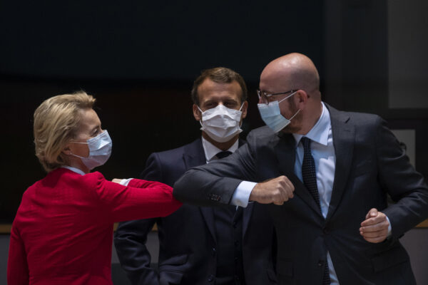 European Commission President Ursula von der Leyen, left, greets European Council President Charles Michel, right, with an elbow bump during a meeting on the sidelines of an EU summit in Brussels, Saturday, July 18, 2020. Leaders from 27 European Union nations meet face-to-face for a second day of an EU summit to assess an overall budget and recovery package spread over seven years estimated at some 1.75 trillion to 1.85 trillion euros. At center is French President Emmanuel Macron. (AP Photo/Francisco Seco, Pool)