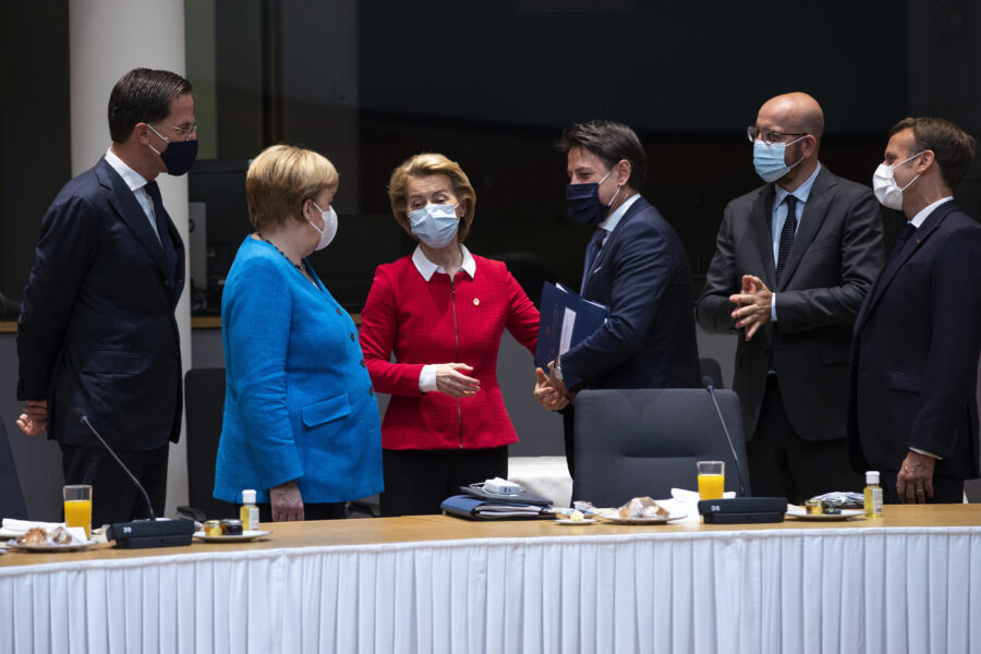 From left, Dutch Prime Minister Mark Rutte, German Chancellor Angela Merkel, European Commission President Ursula von der Leyen, Italy's Prime Minister Giuseppe Conte, European Council President Charles Michel and French President Emmanuel Macron speak during a meeting on the sidelines of an EU summit in Brussels, Saturday, July 18, 2020. Leaders from 27 European Union nations meet face-to-face for a second day of an EU summit to assess an overall budget and recovery package spread over seven years estimated at some 1.75 trillion to 1.85 trillion euros. (AP Photo/Francisco Seco, Pool)