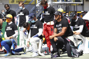 Drivers take a knee n support of the Black Lives Matter movement before the Austrian Formula One Grand Prix race at the Red Bull Ring racetrack in Spielberg, Austria, Sunday, July 5, 2020. (Dan Istitene/Pool via AP)