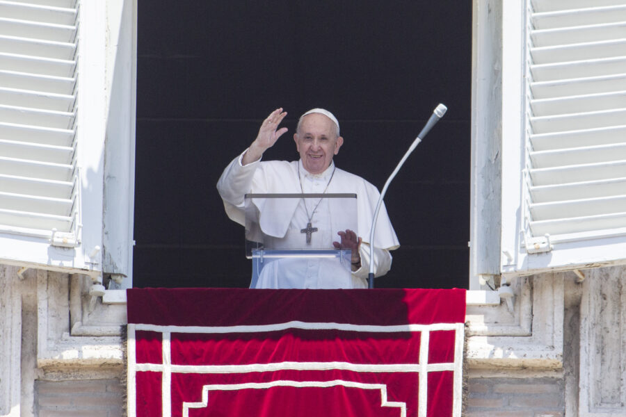 Pope Francis waves to the faithful from the window of his studio overlooking St. Peter's Square at the Vatican, Sunday, June 28, 2020. (AP Photo/Riccardo De Luca)