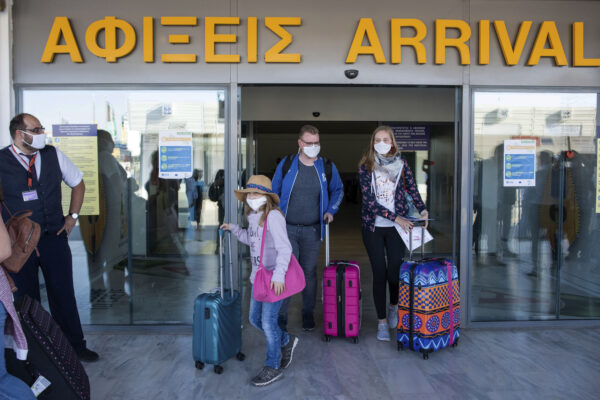 Tourists, arrive at Nikos Kazatzakis International Airport in Heraklion, Crete island, Greece, on Wednesday, July 1, 2020. The passengers most of them from Germany who came from Hamburg, with the first international flight to arrive in the island. Regional airports across Greece, including their tourist destination islands, began accepting direct international flights again on Wednesday, for the first time since flights were banned as part of the country's lockdown to prevent the spread of the coronavirus. (AP Photo/ Harry Nakos )