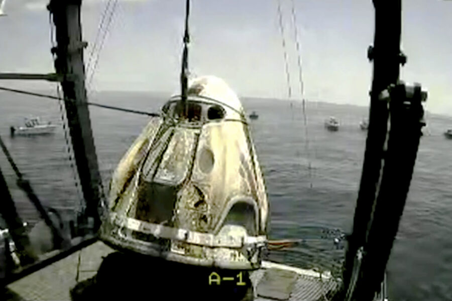 In this frame grab from NASA TV, the SpaceX capsule is lifted onto a ship, Sunday, Aug. 2, 2020 in the Gulf of Mexico. Astronauts Doug Hurley and Bob Behnken spent a little over two months on the International Space Station. It will mark the first splashdown in 45 years for NASA astronauts and the first time a private company has ferried people from orbit. (NASA TV via AP)
