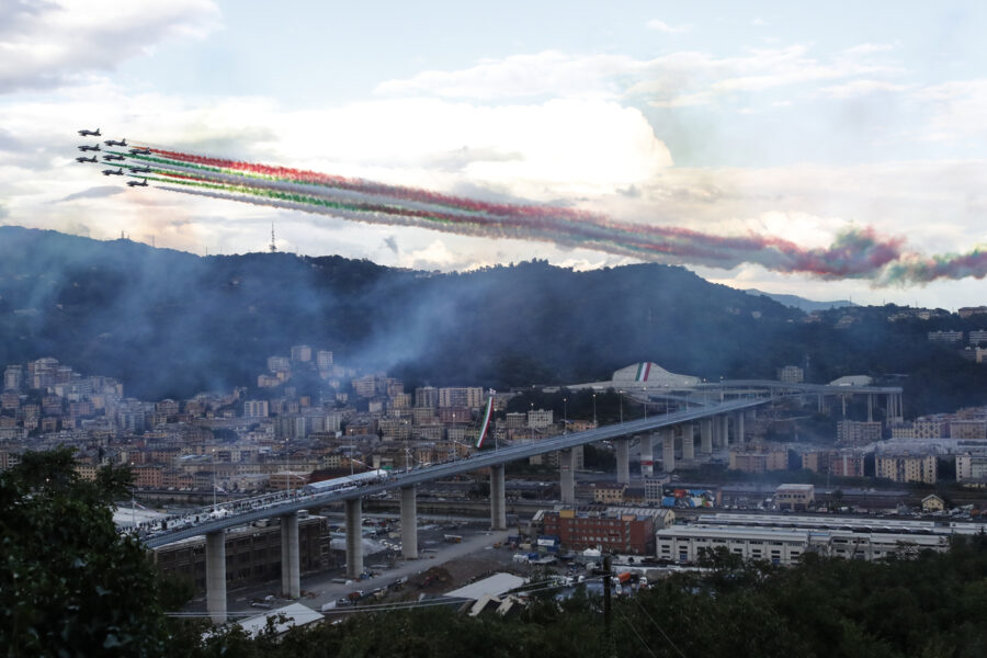The Frecce Tricolore (Three-color Arrows) Italian Air Force aerobatic squad flies over the new San Giorgio Bridge on the occasion of its inauguration in Genoa, Italy, Monday, Aug. 3, 2020. Two years ago this month, a stretch of roadbed collapsed on Genoa's Morandi Bridge, sending cars and trucks plunging to dry riverbed below and ending 43 lives. On Monday, Italy's president journeys to Genoa for a ceremony to inaugurate a replacement bridge. (AP Photo/Antonio Calanni)