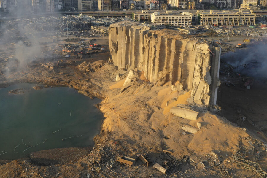 In this drone picture, the destroyed silo sits in rubble and debris after an explosion at the seaport of Beirut, Lebanon, Lebanon, Wednesday, Aug. 5, 2020. The massive explosion rocked Beirut on Tuesday, flattening much of the city's port, damaging buildings across the capital and sending a giant mushroom cloud into the sky. (AP Photo/Hussein Malla)