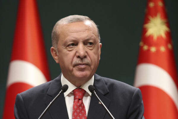 Turkey's President Recep Tayyip Erdogan speaks after a cabinet meeting, in Ankara Turkey, Monday, Aug. 10, 2020. The government of Greece slammed Turkey's announcement that it will be conducting energy exploration in an area of the eastern Mediterranean that Athens says overlaps its continental shelf, as tension over the rights to natural resources increased sharply in the region Monday.(Turkish Presidency via AP, Pool)