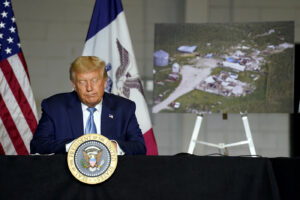 President Donald Trump listens during a briefing on Iowa flood damage and recovery efforts, Tuesday, Aug. 18, 2020, in Cedar Rapids, Iowa. (AP Photo/Evan Vucci)