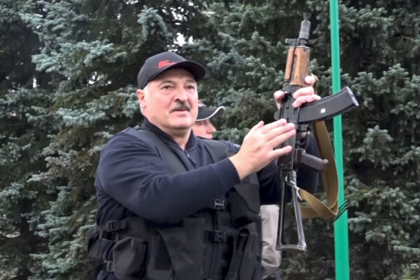 This image made from video provided by the State TV and Radio Company of Belarus, shows Belarus President Alexander Lukashenko armed with a Kalashnikov-type rifle near the Palace of Independence in Minsk, Belarus, Sunday, Aug. 23, 2020. Lukashenko has made a dramatic show of defiance against the massive protests demanding his resignation, toting a rifle and wearing a bulletproof vest as he strode off a helicopter that landed at his residence while demonstrators massed nearby. (State TV and Radio Company of Belarus via AP)