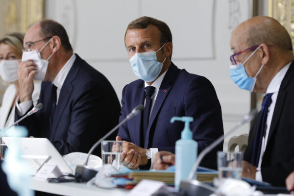 French President Emmanuel Macron, center, chairs a weekly cabinet meeting with Prime Minister Jean Castex, left, and Foreign Minister Jean-Yves le Drian, Wednesday, Aug.26, 2020 at the Elysee Palace in Paris. (AP Photo/Kamil Zihnioglu, Pool)