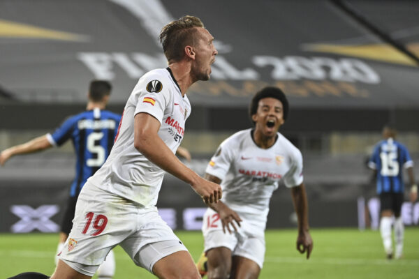 Sevilla's Luuk de Jong celebrates after scoring his side's second goal during the Europa League final soccer match between Sevilla and Inter Milan in Cologne, Germany, Friday, Aug. 21, 2020. (Ina Fassbender/Pool via AP)