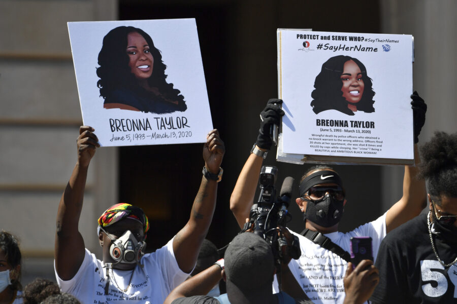 Signs are held up showing Breonna Taylor during a rally in her honor on the steps of the Kentucky State Capitol in Frankfort, Ky., Thursday, June 25, 2020. The rally was held to demand justice in the death of Taylor who was killed in her apartment by members of the Louisville Metro Police Department on March 13, 2020. (AP Photo/Timothy D. Easley)