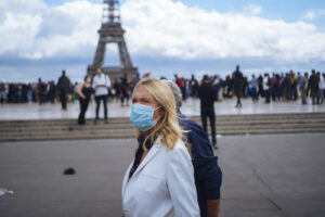People wearing face masks stroll at Trocadero plaza near the Eiffel Tower, in Paris, Saturday, Aug. 29, 2020. France registered more than 7,000 new virus infections in a single day Friday, up from several hundred a day in May and June, in part thanks to ramped-up testing. Masks are now required everywhere in public in Paris as authorities warn that infections are growing exponentially. (AP Photo/Kamil Zihnioglu)