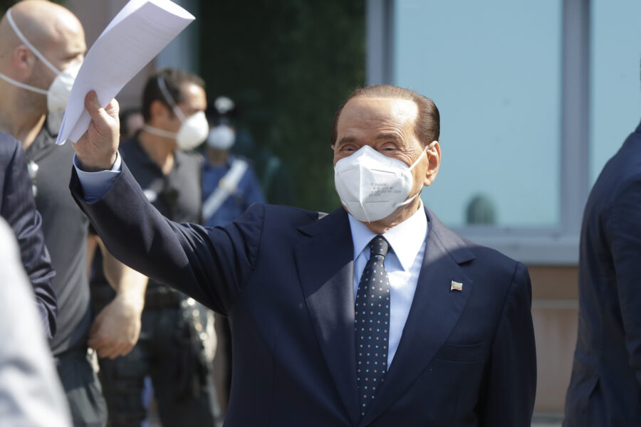 Italian former Premier Silvio Berlusconi waves as he leaves the San Raffaele hospital in Milan, Italy, Monday, Sept. 14, 2020. Berlusconi had been hospitalized as a precaution to monitor his coronavirus infection after testing positive for COVID-19. (AP Photo/Luca Bruno)