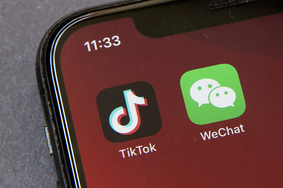 """FILE – Icons for the smartphone apps TikTok and WeChat are seen on a smartphone screen in Beijing, in a Friday, Aug. 7, 2020 file photo.  The Commerce Department said President Trump's proposed ban of the apps WeChat and TikTok will go into effect Sunday, Sept. 20,  to """"safeguard the national security of the United States."""" The government said its order, previously announced by Trump in August, will """"combat China's malicious collection of American citizens' personal data.""""  (AP Photo/Mark Schiefelbein, File)"""
