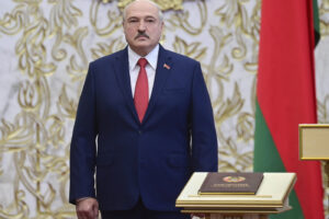 Belarusian President Alexander Lukashenko attends his inauguration ceremony at the Palace of the Independence in Minsk, Belarus, Wednesday, Sept. 23, 2020. Lukashenko of Belarus has assumed his sixth term of office in an inauguration ceremony that wasn't announced in advance. State news agency BelTA reports that the ceremony will take place with several hundred top government official present (Andrei Stasevich/Pool Photo via AP)