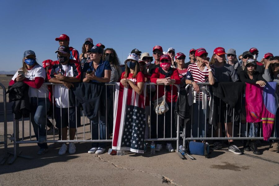 Supporters of President Donald Trump listen to him speak during a campaign rally at Phoenix Goodyear Airport, Wednesday, Oct. 28, 2020, in Goodyear, Ariz. (AP Photo/Evan Vucci)
