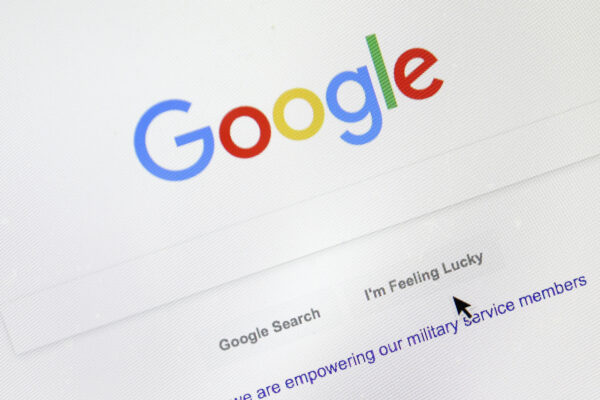 FILE – In this Aug. 28, 2018, file photo, a cursor moves over Google's search engine page, in Portland, Ore. A French appeals court on Thursday, Oct. 8, 2020 upheld an order for Google to pay media companies to show their news content in search results. The Paris Court of Appeal rejected a challenge by the U.S. tech company, which had refused to comply with an order by France's competition authority to negotiate with publishers and press agencies for payments to display their material. (AP Photo/Don Ryan, File)