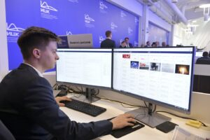 """In this photo taken on Tuesday, March 17, 2020, An employee of a call center of the emergency response center on control and monitoring of the coronavirus disease, in Moscow, Russia. Russian authorities declared a war on """"fake news"""" related to the new coronavirus. The crusade was triggered by what looked like a real disinformation campaign, but as the outbreak in Russia picked up speed and criticism of the Kremlin's """"it is under control"""" stance mounted, the authorities cracked down on social media users doubting the official numbers and news outlets questioning the government's response to the epidemic. (Alexander Astafyev, Sputnik, Kremlin Pool Photo via AP)"""