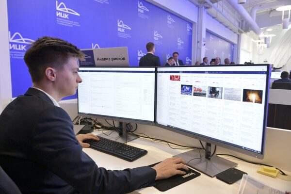 "In this photo taken on Tuesday, March 17, 2020, An employee of a call center of the emergency response center on control and monitoring of the coronavirus disease, in Moscow, Russia. Russian authorities declared a war on ""fake news"" related to the new coronavirus. The crusade was triggered by what looked like a real disinformation campaign, but as the outbreak in Russia picked up speed and criticism of the Kremlin's ""it is under control"" stance mounted, the authorities cracked down on social media users doubting the official numbers and news outlets questioning the government's response to the epidemic. (Alexander Astafyev, Sputnik, Kremlin Pool Photo via AP)"