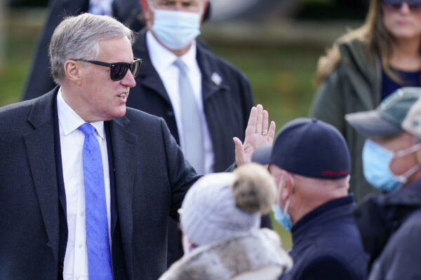 White House Chief of Staff Mark Meadows talks with supporters before President Donald Trump speaks at a campaign rally at Keith House, Washington's Headquarters, Saturday, Oct. 31, 2020, in Newtown, Pa. (AP Photo/Chris Szagola)