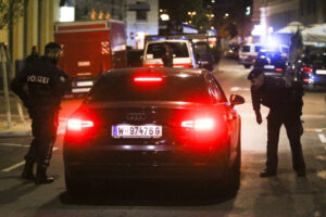 Police officers check a car at the scene after gunshots were heard, in Vienna, Monday, Nov. 2, 2020. Austrian police say several people have been injured and officers are out in force following gunfire in the capital Vienna. Initial reports that a synagogue was the target of an attack couldn't immediately be confirmed. Austrian news agency APA quoted the country's Interior Ministry saying one attacker has been killed and another could be on the run.(Photo/Ronald Zak)