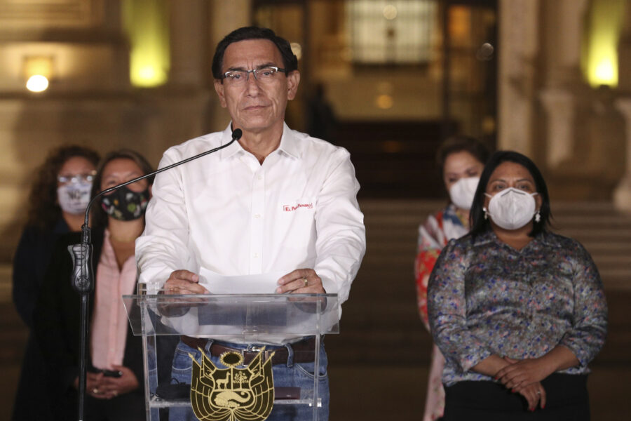 Peru's President Martin Vizcarra speaks in front of the presidential palace after lawmakers voted to remove him from office in Lima, Peru, Monday, Nov. 9, 2020. Lawmakers voted to impeach Vizcarra, accusing him of taking bribes years ago and poorly handling the country's response to the coronavirus pandemic. (AP Photo/Martin Mejia)